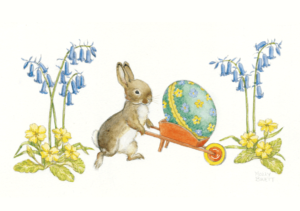 Rabbit pushing a decorated Easter Egg in a Wheelbarrow